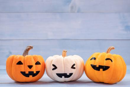 three small jack-o-lanterns with cute expressions
